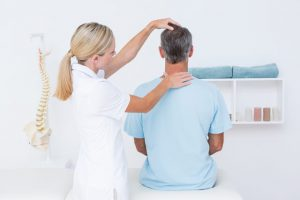 The chiropractor checks and evaluates the spinal cord of the patient.