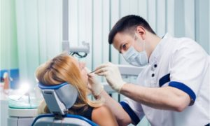The dentist explains that the necessary treatment is not the most painful dental procedure.